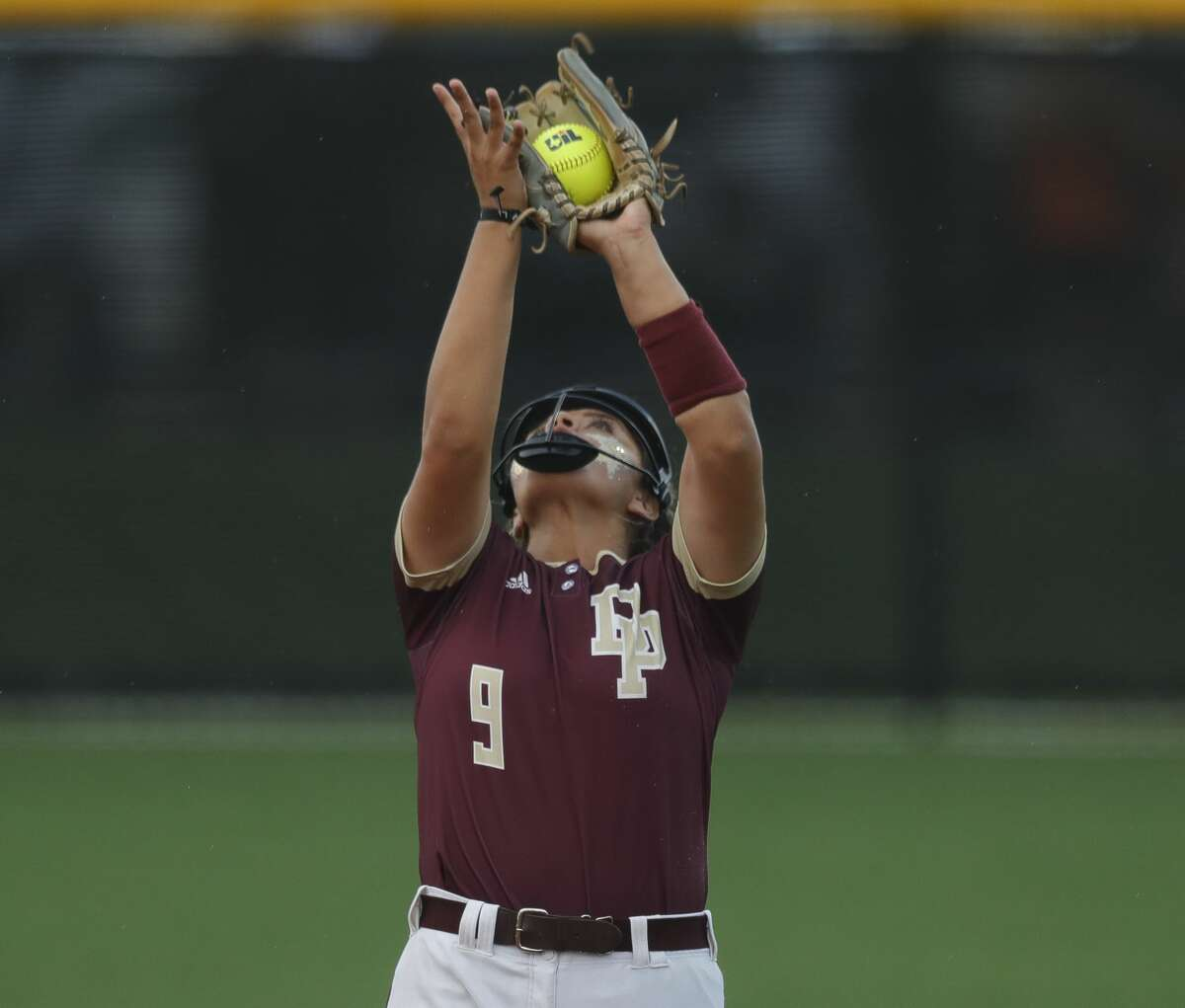 Deer Park second baseman Bryanna Fuentes (9) catches a fly ball by Carsyn Lee #8 of Flower Mound in the second inning of a Class 6A state semifinal game, Friday, June 4, 2021, in Leander.