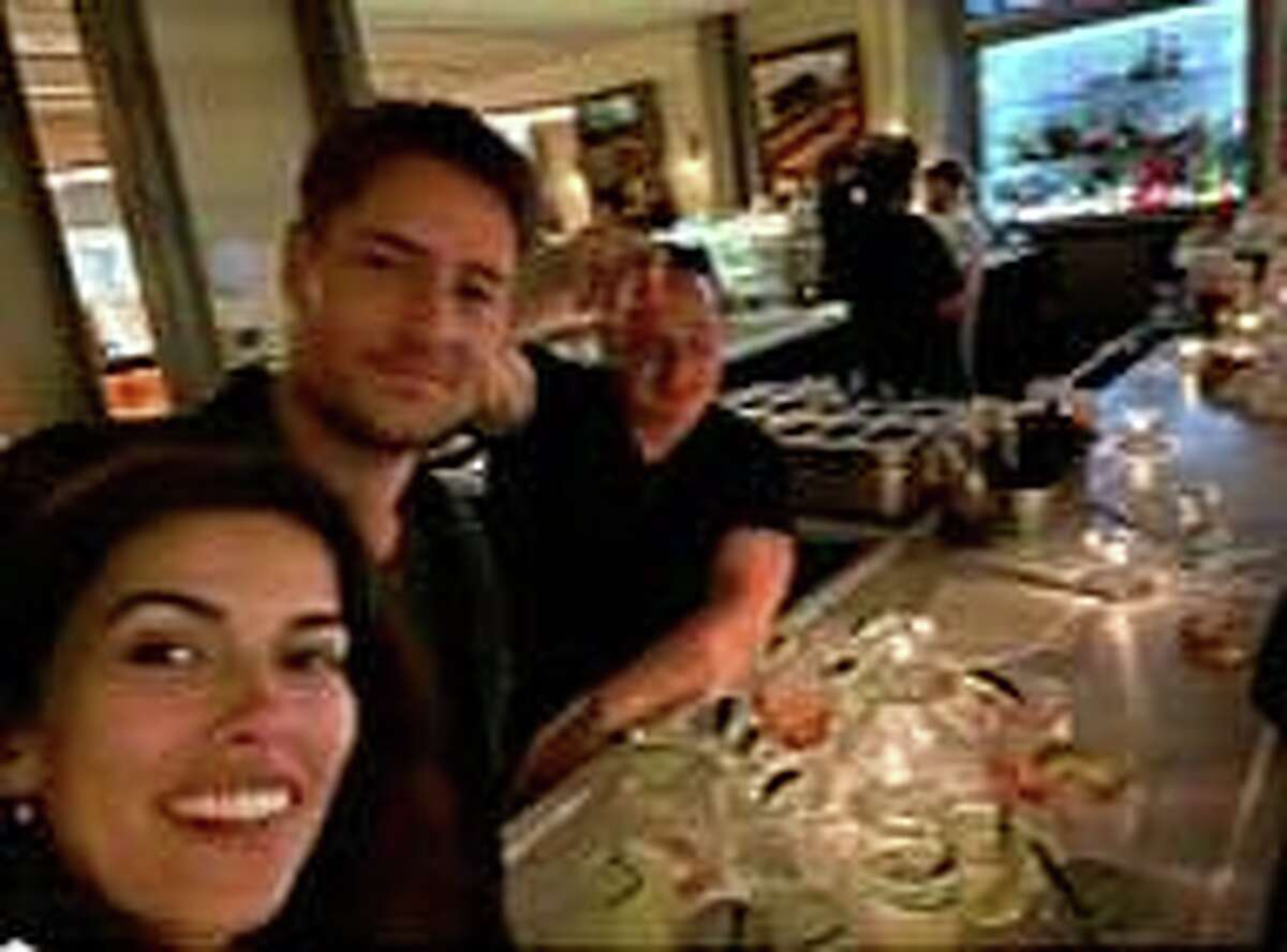 """""""This is Us"""" star Justin Hartley and his wife, Sofia Pernas, chat with Sal LoBalbo of LoBalbo Auto Body in Stamford at Eastend restaurant on Greenwich Avenue last month."""