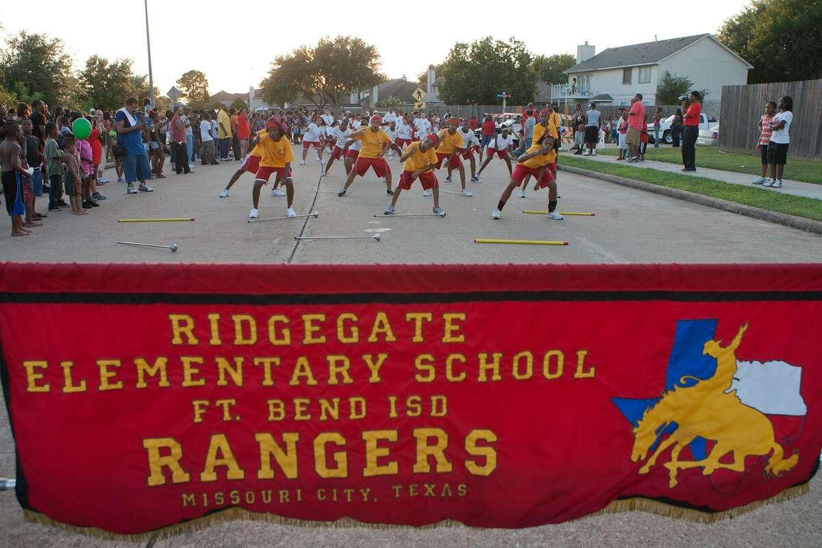 The Ridgegate Rangers Drum Major Corps dances at a previous Missouri City Juneteenth Parade.