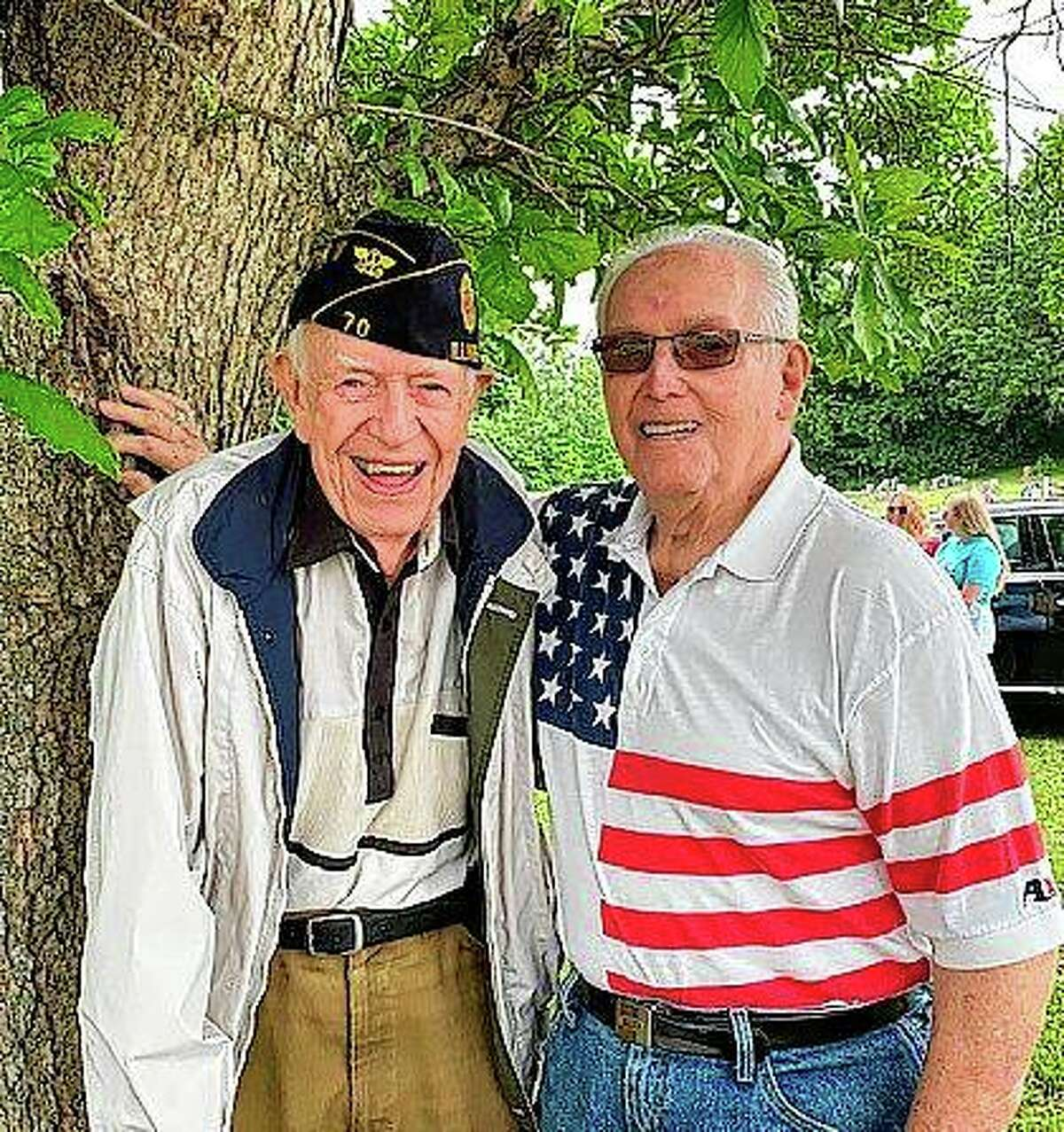 John Neece (left) and Bill Martin participate Monday in a Memorial Day service in White Hall. Neece, 99, and Martin, who will be 97 in July, are World War II veterans.