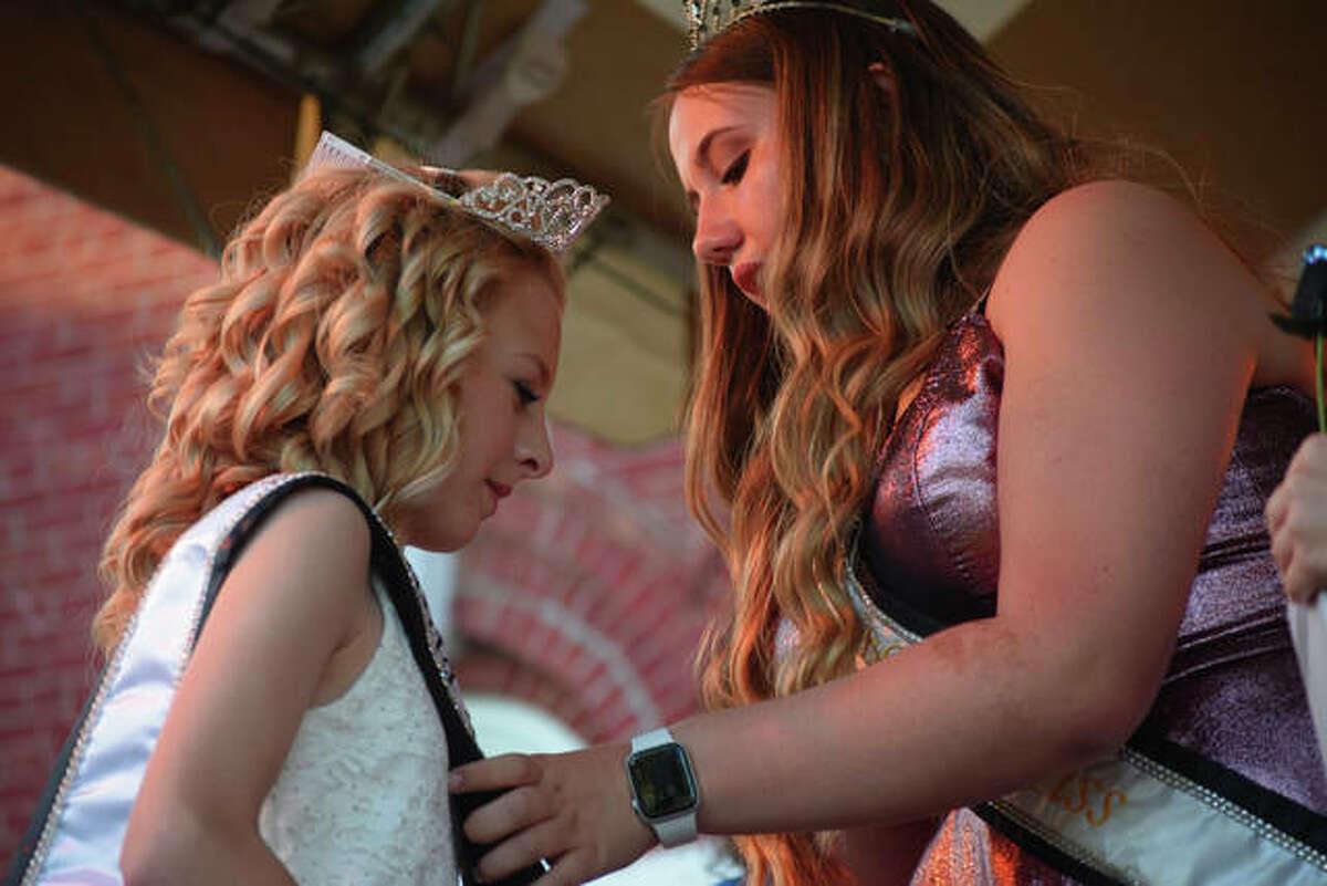 Chelsea Bell (right), the 2019 Junior Miss Virginia Bar-B-Que, crowns the 2021 Junior Miss Virginia Bar-B-Que Jersey Henson Friday.
