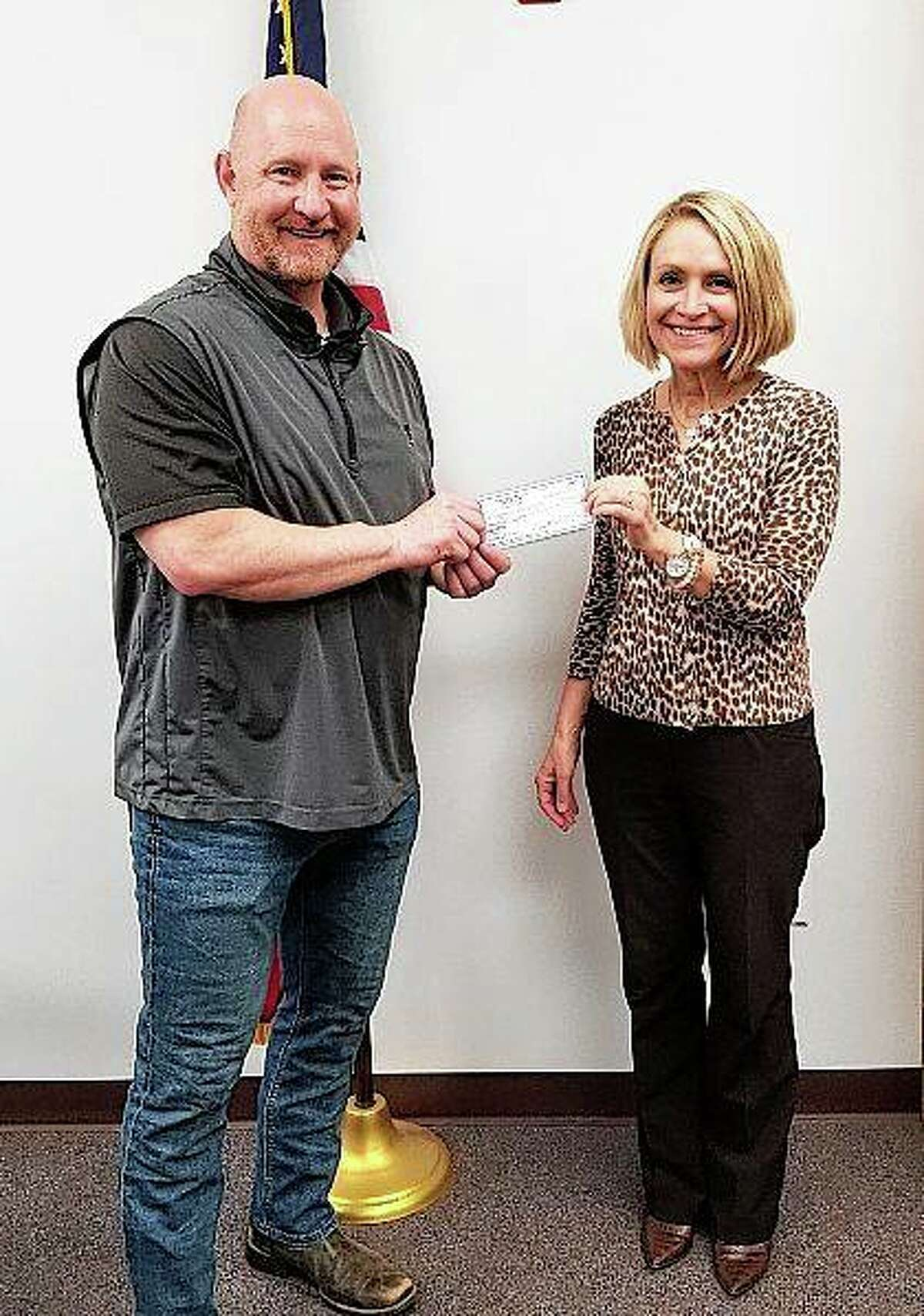 Rotary Club of Pike County President Sheila Davidsmeyer presents a check to Griggsville-Perry schools Superintendent Kent Hawley. The money was designated for the district's personal protective equipment purchases amid the COVID-19 pandemic.