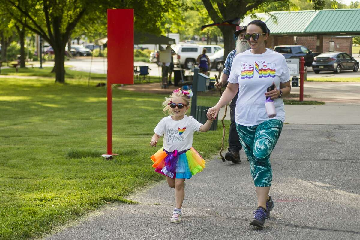 Shay Luptowski, right, and Monreau Khoriaty, 4, left, take off on the rail trail while participating in a local Stride for Pride event hosted by Michigan GLAD, a Dow LGBTQ+ and ally employee resource group, Saturday, June 5, 2021 beginning at the Tridge in Midland. (Katy Kildee/kkildee@mdn.net)