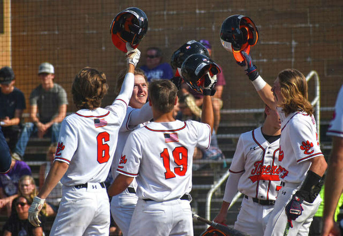 Edwardsville's Hayden Moore is congratulated by teammates after his grand slam in the second inning of Friday's game against Collinsville in a Class 4A regional semifinal.