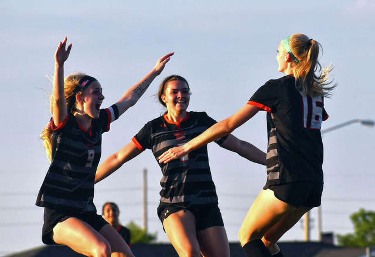 Edwardsville's Maddie Hawley, right, is congratulated by teammates after scoring the game-winning goal in the 72nd minute.