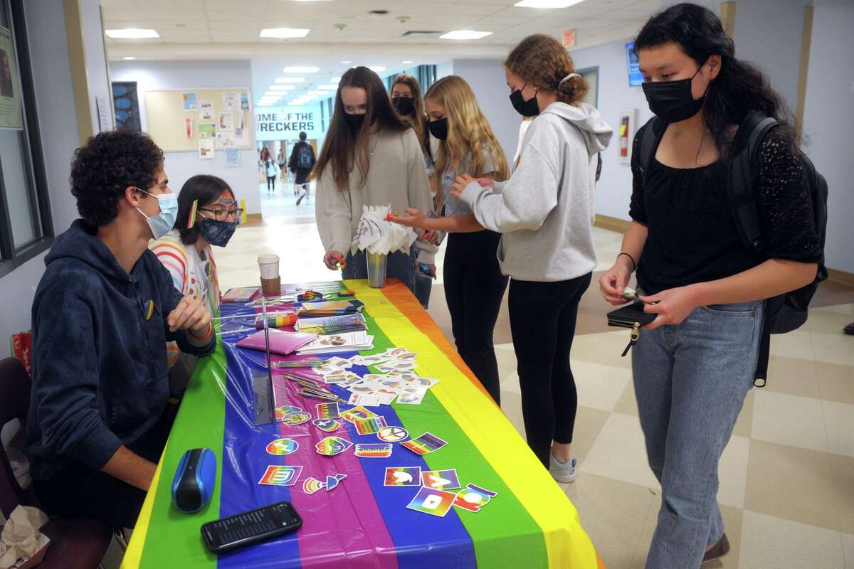 Students look over Pride day-related items for sale at Staples High School in Westport on Friday. The high school held its first Pride day celebration on Friday.