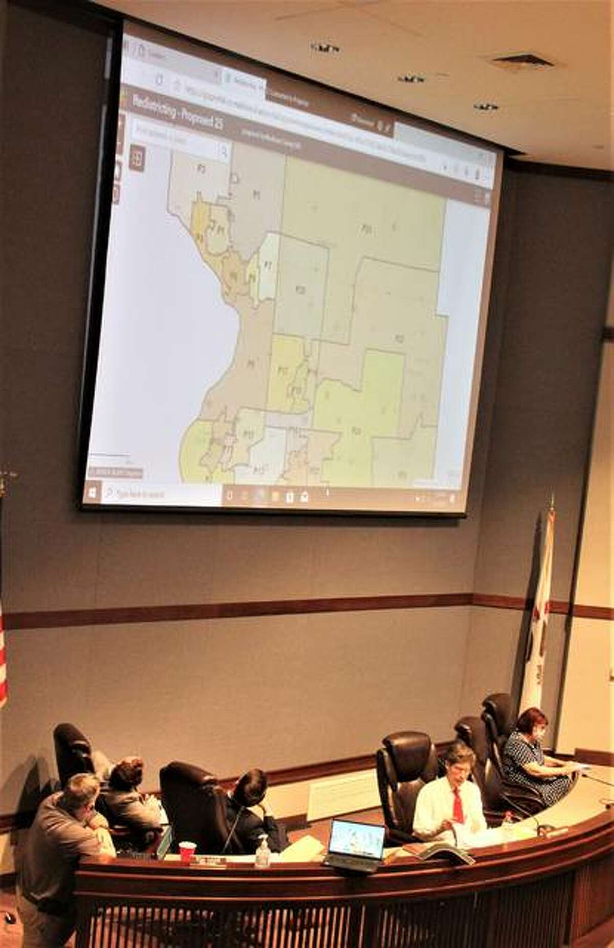 Madison County Board members discuss a proposed redistricting map during a special meeting in early May. The map would have reduced the number of board seats to 25 from the current 29, but was soundly defeated.
