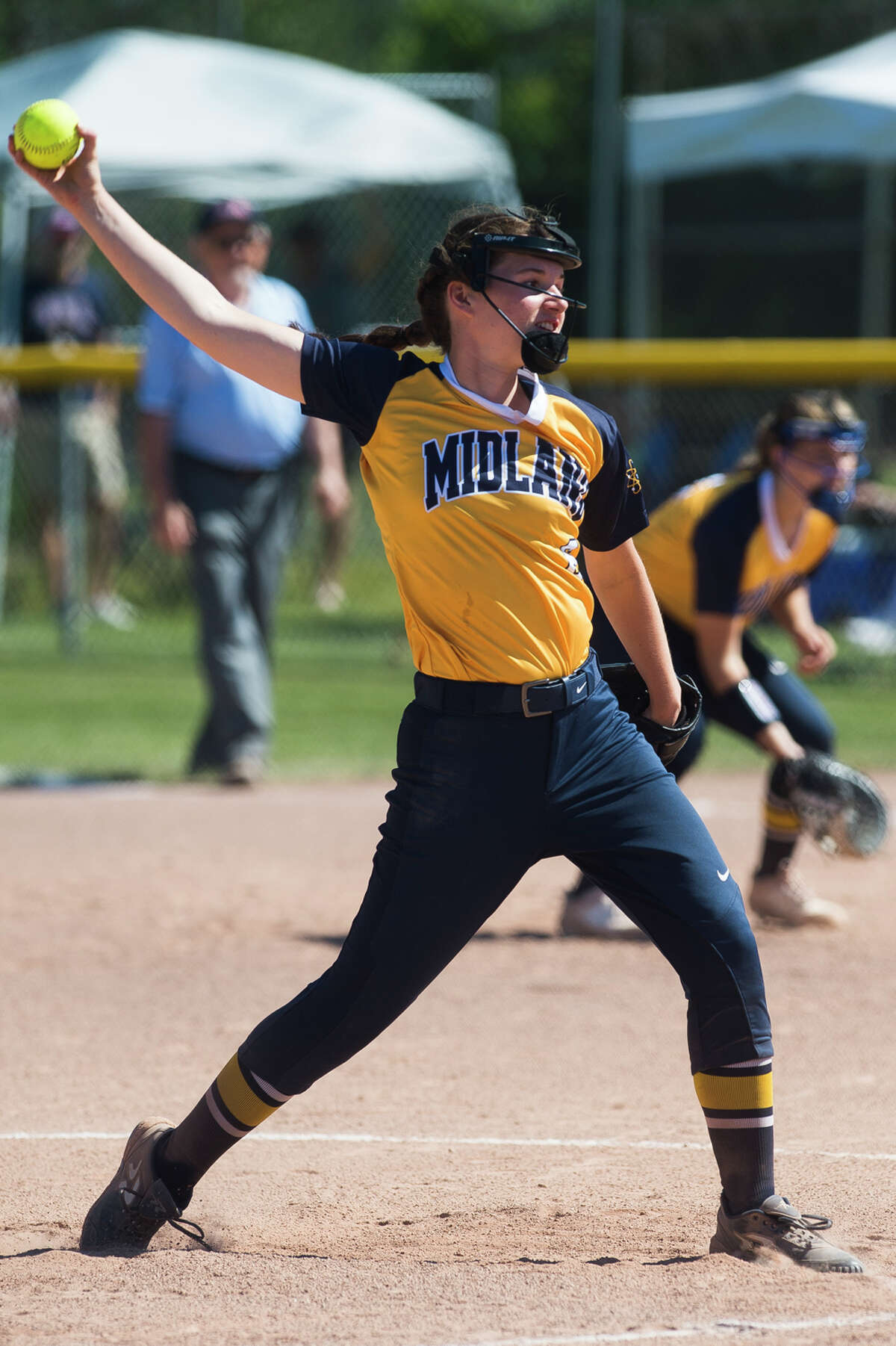 Midland's Rachel Mecca pitches the ball during the Chemics' game against Dow Saturday, June 5, 2021 at Bay City Western High School. (Katy Kildee/kkildee@mdn.net)