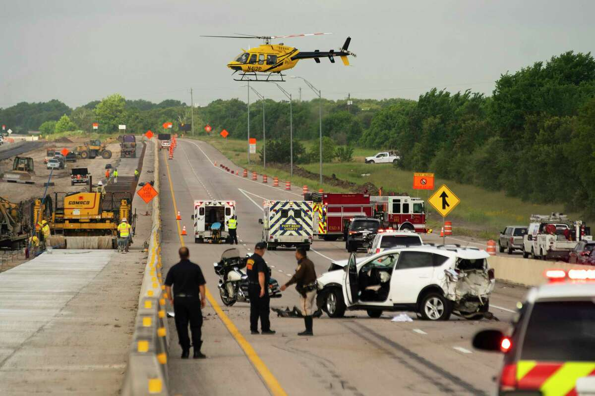 The southbound lanes of U.S. 59 are shut down in Kendleton, in Fort Bend County southwest of Rosenberg, May 11, 2021, as emergency personnel, including a helicopter, respond to a wreck.