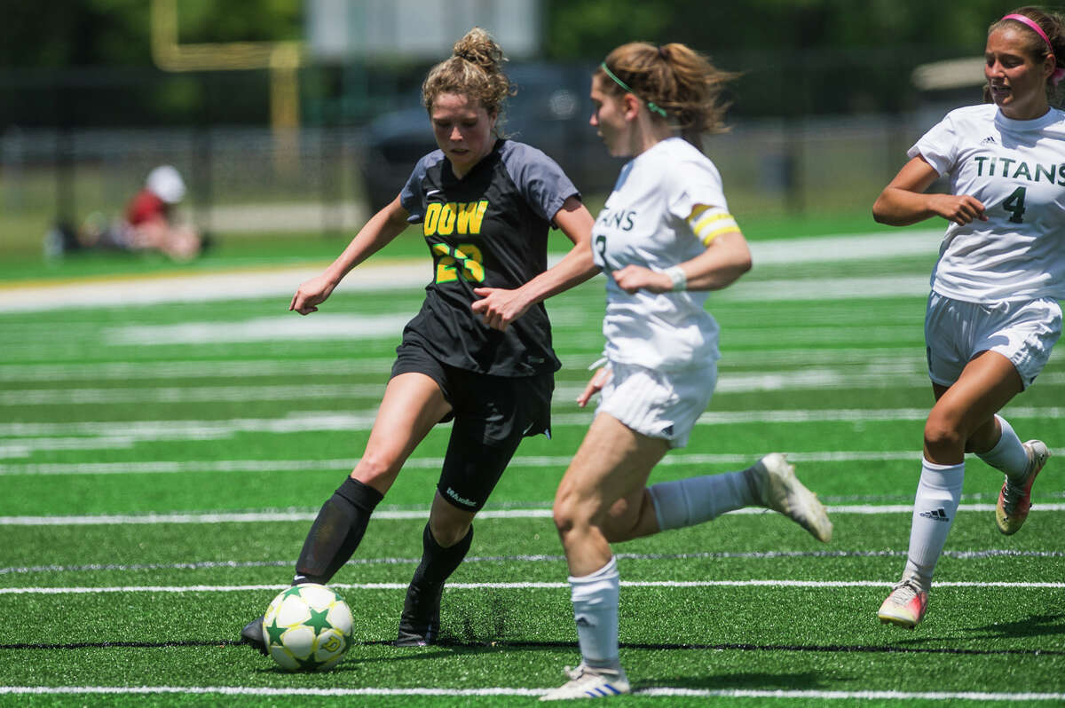 Dow's Kennedy Caldwell dribbles down the field during the Chargers' district championship win over Traverse City West Saturday, June 5, 2021 at H. H. Dow High School. (Katy Kildee/kkildee@mdn.net)