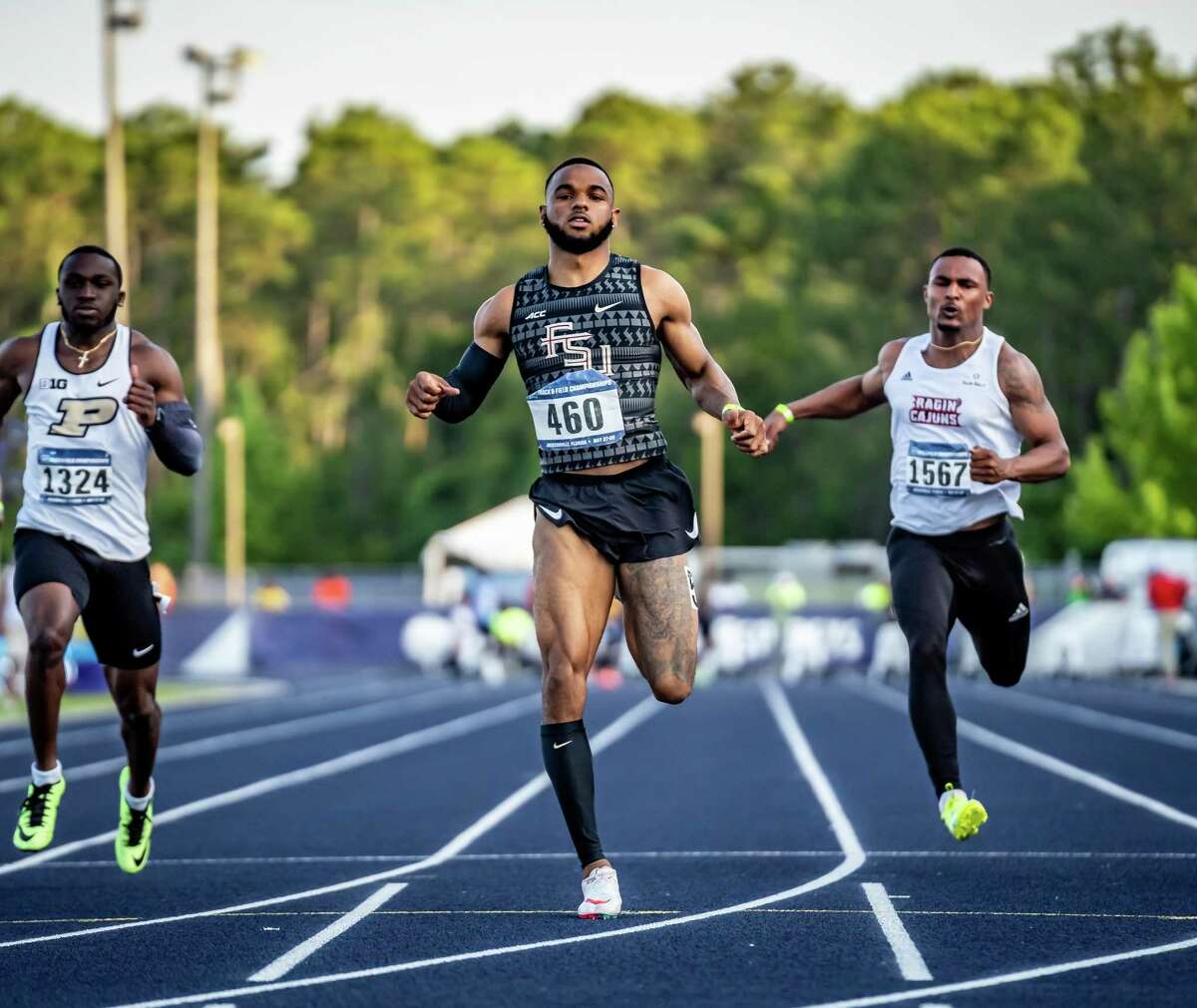 Florida State sprinter and Conroe High School alum Jo'Vaughn Martin runs during the NCAA East Preliminaries in Jacksonville.