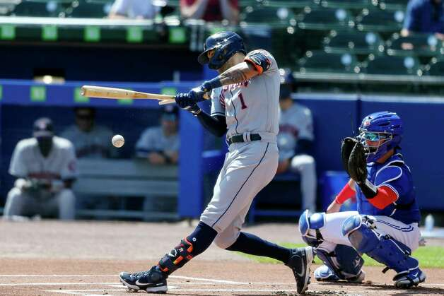 Houston Astros' Carlos Correa (1) hits a broken-bat single during the first inning of a baseball game against the Toronto Blue Jays in Buffalo, N.Y., Saturday, June 5, 2021. (AP Photo/Joshua Bessex) Photo: Joshua Bessex, Associated Press / Copyright 2021 The Associated Press. All rights reserved