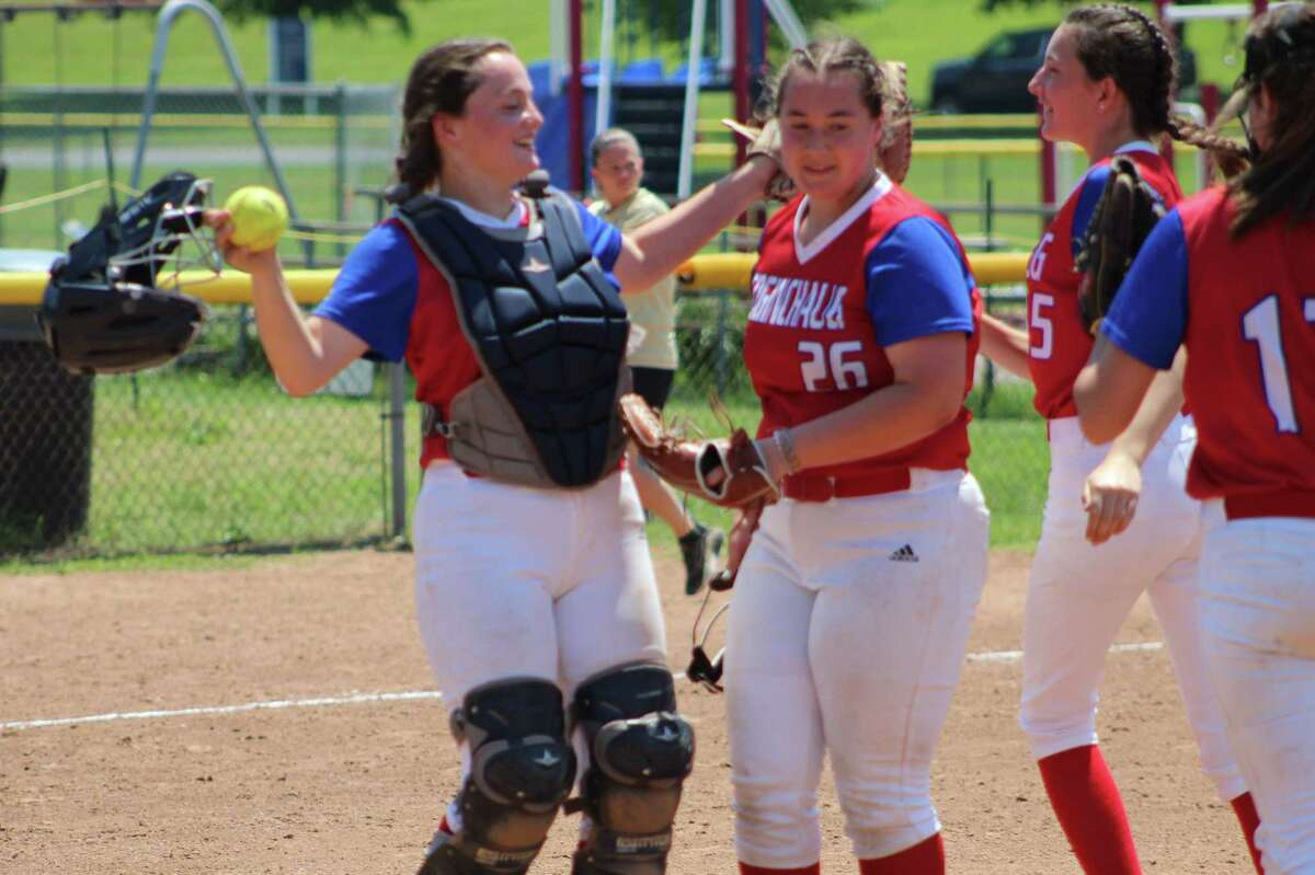 Catcher Dana Boothroyd meets her sister at the mound after Kelly Boothroyd finished off a one-hit shutout of Thomaston on Saturday.
