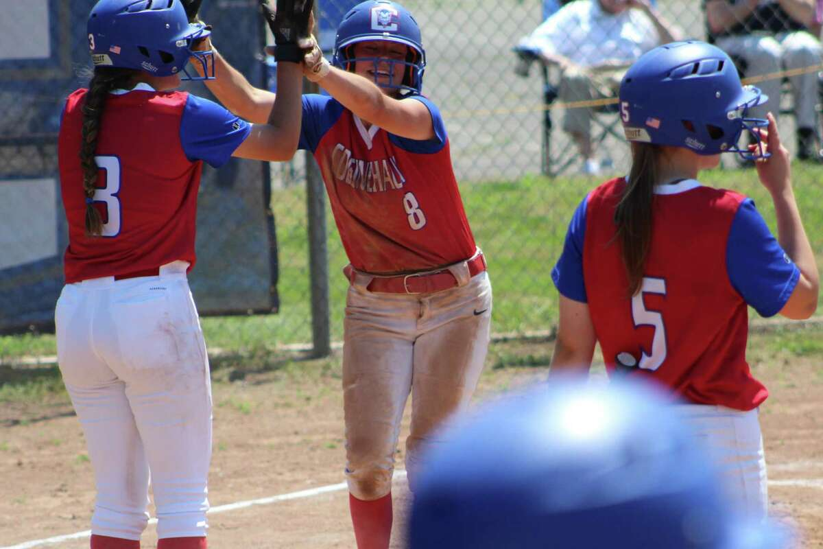 Amalia DeMartino (8) is met by teammate Ava Marenna, left, after the two scored on a hit by Jackie Kelly in the second inning. DeMartino had a 4-for-4 day at the plate.