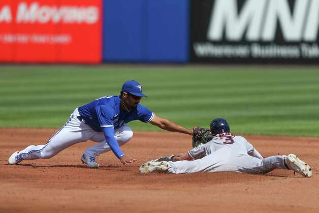 Toronto Blue Jays' second baseman Marcus Semien (10) is late to tag Houston Astros Myles Straw (3) as Straw steals second during the third inning of a baseball game in Buffalo, N.Y., Saturday, June 5, 2021. (AP Photo/Joshua Bessex) Photo: Joshua Bessex, Associated Press / Copyright 2021 The Associated Press. All rights reserved
