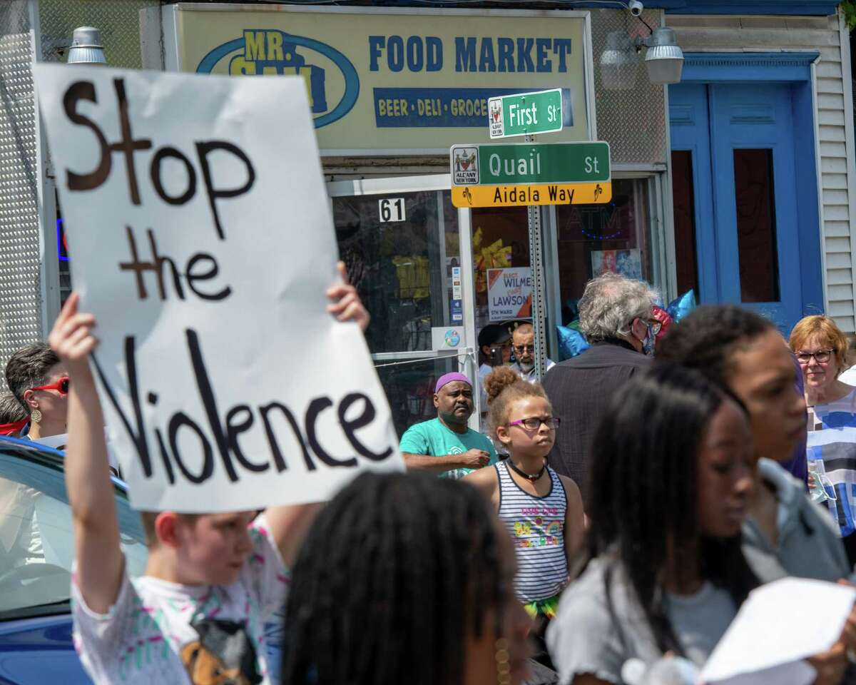 Local activists and business and community members marched from Swinburne Park through the streets of Albany, NY, Saturday, June 5, to call for an end to the violence that has plagued the city this year. The marchers stopped for a moment of silence at a number of spots where people have been killed this year. Above is First and Quail streets, where Dany Pearson was shot and killed on May 10. (Jim Franco/Special to the Times Union.)