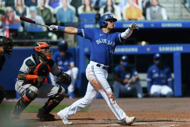 Toronto Blue Jays' Joe Panik (2) watches the ball as he hits a three-run home run in the fourth inning of a baseball game against the Houston Astros in Buffalo, N.Y., Saturday, June 5, 2021. (AP Photo/Joshua Bessex) Photo: Joshua Bessex, Associated Press / Copyright 2021 The Associated Press. All rights reserved