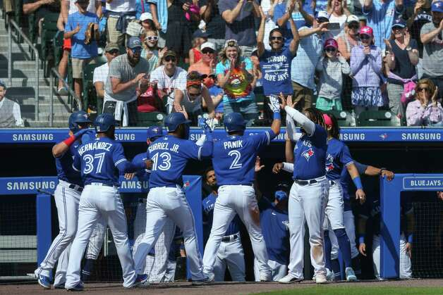 Teammtes and fans celebrate after Toronto Blue Jays' Joe Panik (2) hit a three-run home run scoring Teoscar Hernandez (37) and Lourdes Gurriel Jr. (13) during the fourth inning of a baseball game against the Houston Astros in Buffalo, N.Y., Saturday, June 5, 2021. (AP Photo/Joshua Bessex) Photo: Joshua Bessex, Associated Press / Copyright 2021 The Associated Press. All rights reserved