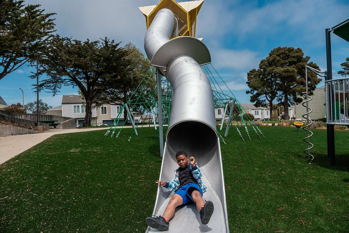 Jaecieon Lowe, 8, enjoys the slide at the renovated Shoreview Park in San Francisco. The Hunters Point playground got a $3.3 million makeover.