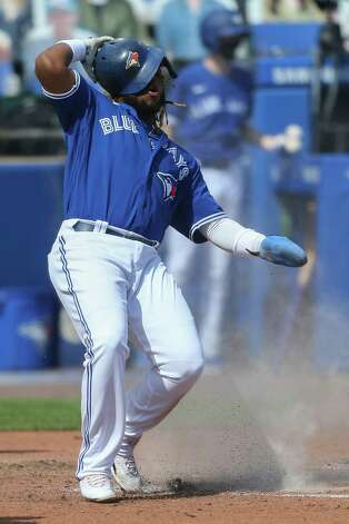 Toronto Blue Jays' Vladimir Guerrero Jr. gets up after sliding across home plate to score on a single by Lourdes Gurriel Jr. during the fourth inning of a baseball game against the Houston Astros in Buffalo, N.Y., Saturday, June 5, 2021. (AP Photo/Joshua Bessex) Photo: Joshua Bessex, Associated Press / Copyright 2021 The Associated Press. All rights reserved