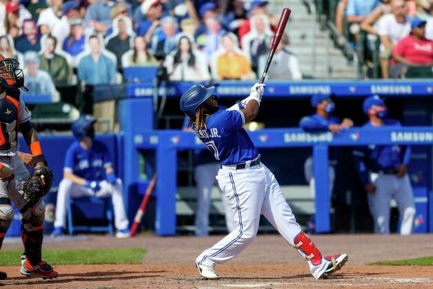 Toronto Blue Jays' Vladimir Guerrero Jr. (27) watches his two-run home run sail over the wall during the fifth inning of a baseball game against the Houston Astros in Buffalo, N.Y., Saturday, June 5, 2021. (AP Photo/Joshua Bessex) Photo: Joshua Bessex, Associated Press / Copyright 2021 The Associated Press. All rights reserved