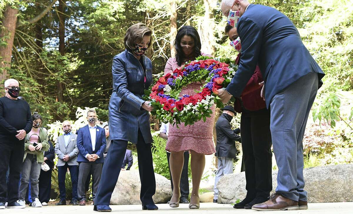 House Speaker Nancy Pelosi (left), San Francisco Mayor London Breed, Rep. Barbara Lee and AIDS survivor John Cunningham place a wreath at the National AIDS Memorial Grove.