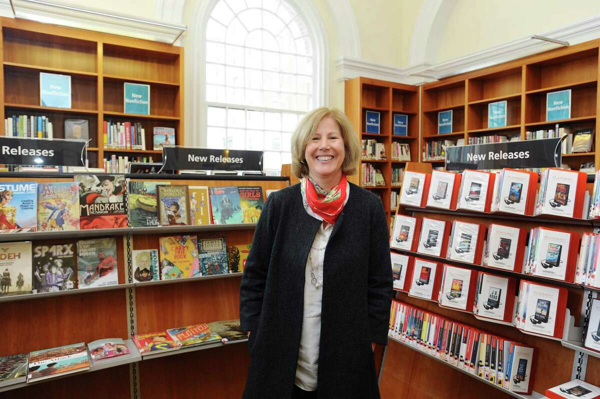 Ferguson Librarian Alice Knapp poses for a photo inside the main branch of the library in downtown Stamford, Conn. on Wednesday, April 5, 2017.