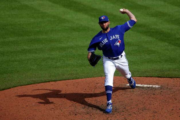 Toronto Blue Jays relief pitcher Tim Mayza (58) throws during the sixth inning of a baseball game against the Houston Astros in Buffalo, N.Y., Saturday, June 5, 2021. (AP Photo/Joshua Bessex) Photo: Joshua Bessex, Associated Press / Copyright 2021 The Associated Press. All rights reserved
