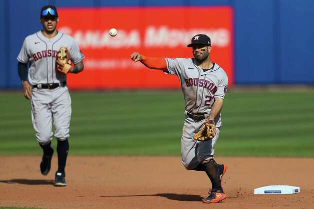 Houston Astros' second baseman Jose Altuve (27) throws to first base to complete a double play on Toronto Blue Jays' Randal Grichuk after forcing out Vladimir Guerrero Jr. at second during the seventh inning of a baseball game in Buffalo, N.Y., Saturday, June 5, 2021. (AP Photo/Joshua Bessex) Photo: Joshua Bessex, Associated Press / Copyright 2021 The Associated Press. All rights reserved