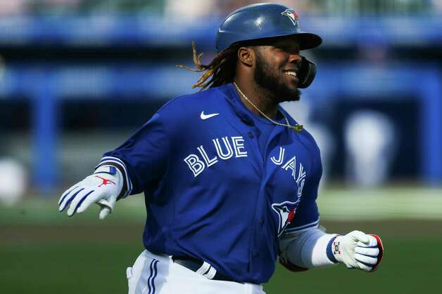 Toronto Blue Jays' Vladimir Guerrero Jr. (27) reaches first base on a single during the seventh inning of a baseball game against the Houston Astros in Buffalo, N.Y., Saturday, June 5, 2021. (AP Photo/Joshua Bessex) Photo: Joshua Bessex, Associated Press / Copyright 2021 The Associated Press. All rights reserved