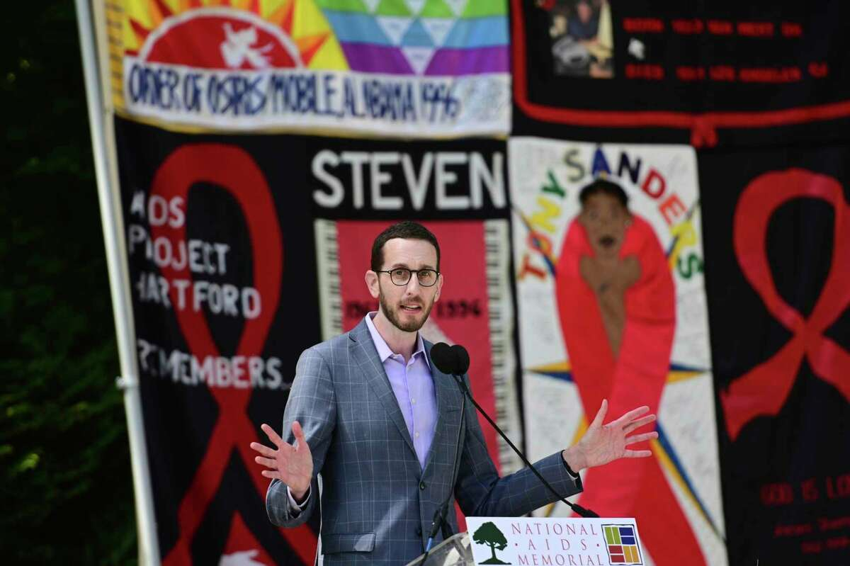 California state Sen. Scott Wiener speaks at a ceremony for the 40th anniversary of the AIDS pandemic in San Francisco earlier in June. University of California regents approved a new policy Wednesday in response to Wiener's legislation that would require UC to end contracts with religious health facilities that prohibited certain procedures. Wiener later endorsed amendments to the policy.