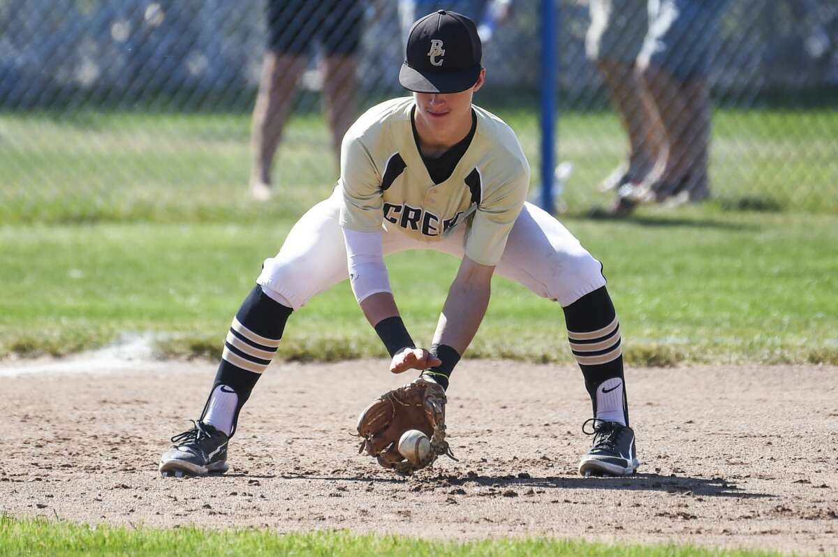 Bullock Creek's Nathan Masar fields a ball during a district semifinal against Freeland Saturday, June 5, 2021 at Garber High School. (Adam Ferman/for the Daily News)