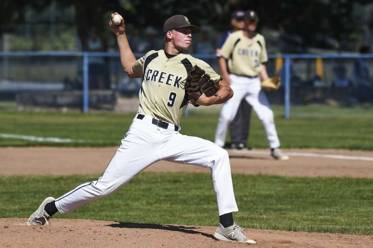 Bullock Creek's Jacob Wanous delivers a pitch during a district semifinal against Freeland Saturday, June 5, 2021 at Garber High School. (Adam Ferman/for the Daily News)