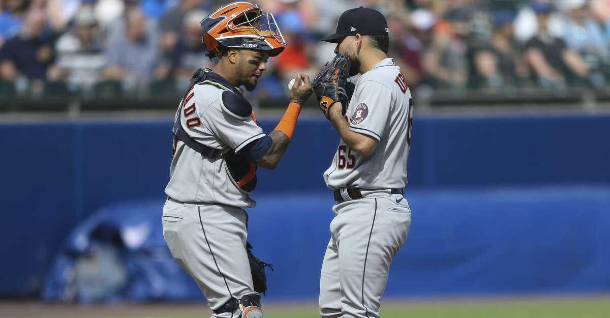 Houston Astros catcher Martin Maldonado (15) meets on the mound with starting pitcher Jose Urquidy (65) during the fourth inning of a baseball game against the Toronto Blue Jays in Buffalo, N.Y., Saturday, June 5, 2021. (AP Photo/Joshua Bessex)