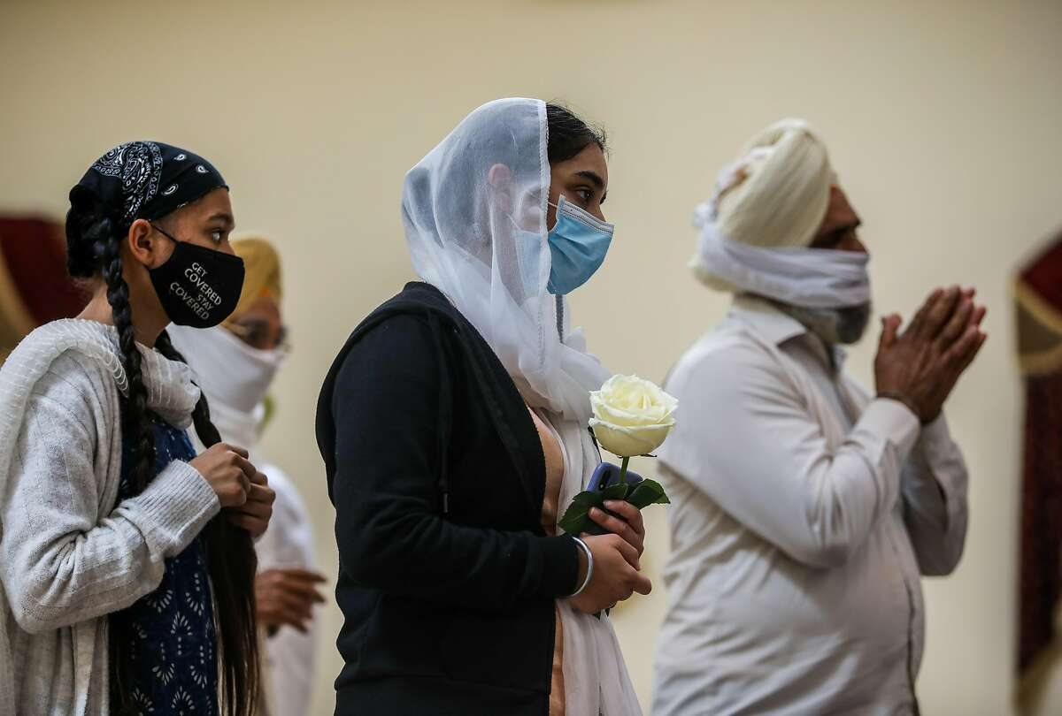 Folks attend a memorial service for Taptejdeep Singh at Sikh Gurdwara, on Saturday, June 5, 2021, in Fremont, Calif.