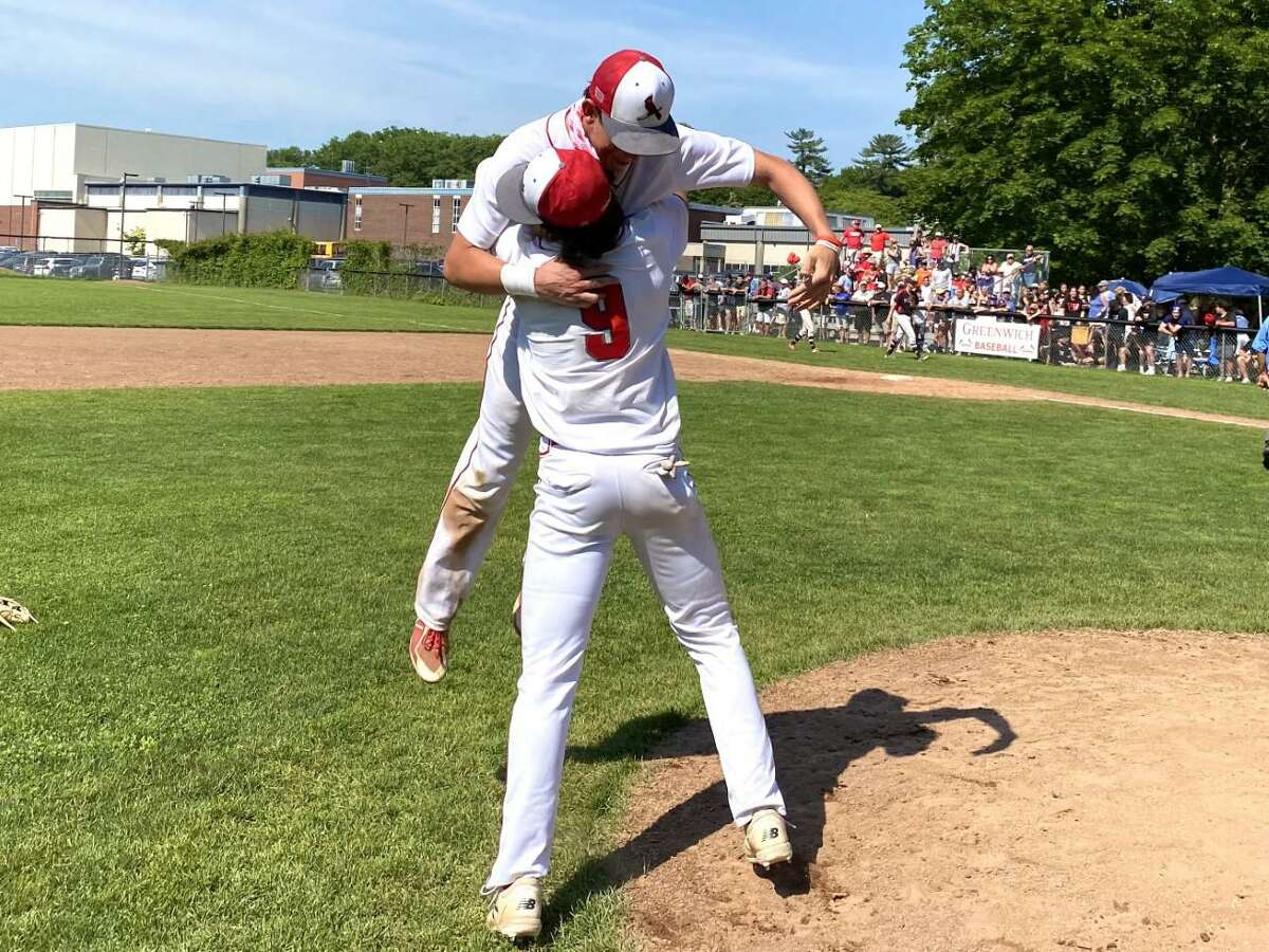 Tyler Cusimano lifts up Cage Lasley after Greenwich beat Warde in the Class LL quarterfinals. Lasley drove in go-ahead run in the sixth inning on Saturday.