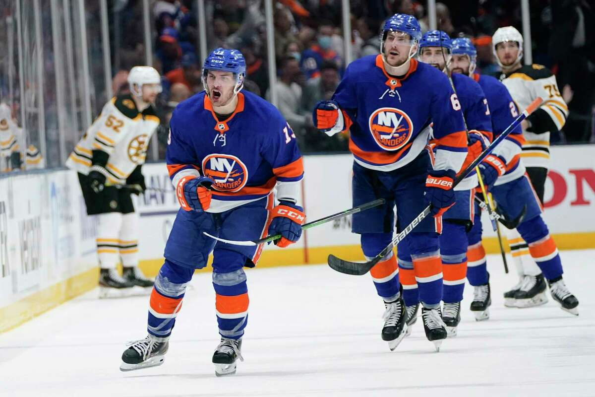 New York Islanders' Mathew Barzal (13) celebrates with teammates after scoring a goal during the third period of Game 3 of the team's NHL hockey second-round playoff series against the Boston Bruins on Thursday, June 3, 2021, in Uniondale, N.Y. (AP Photo/Frank Franklin II)