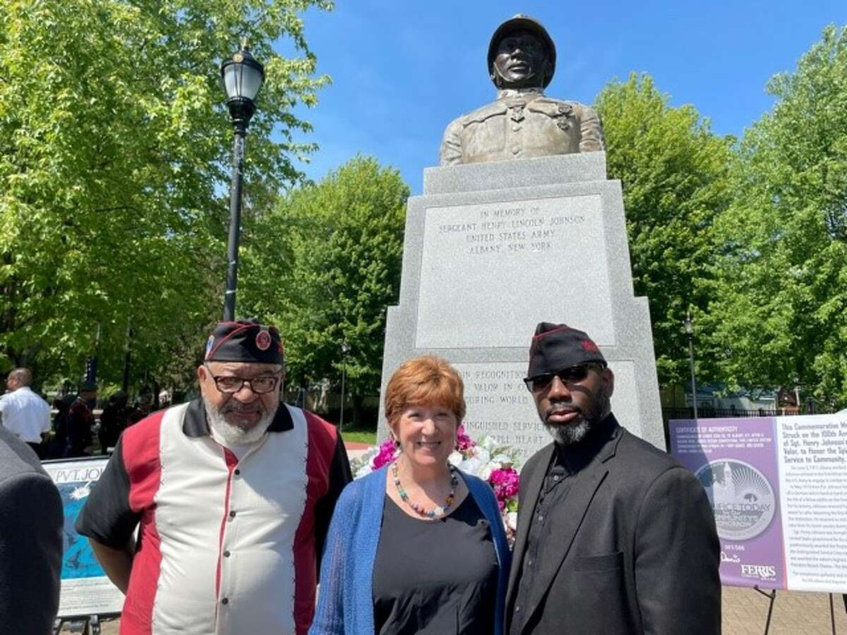 369th Regiment veterans pose by one of the two statues of Henry Johnson in Albany. From left to right: veteran Jim Dandles, Mayor Cathy Sheehan and veteran Ronald Wilson, president of the Albany District of the 369th Veterans Association.