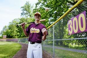 Colonie outfielder Zach Ashline poses for a photo near the outfield fence at Colonie High School on Tuesday, June 1, 2021, in Colonie, N.Y.   (Paul Buckowski/Times Union)