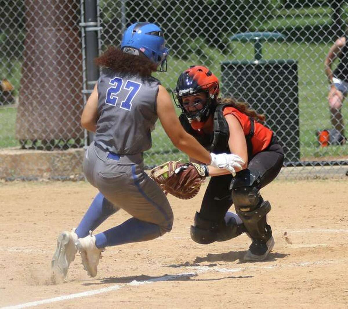 Gilliespie catcher Hannah Barrett (right) braces to put the tag on Jalynn Dickson for an out at the plate Saturday in a Class 2A regional title game at Moore Park in Alton.