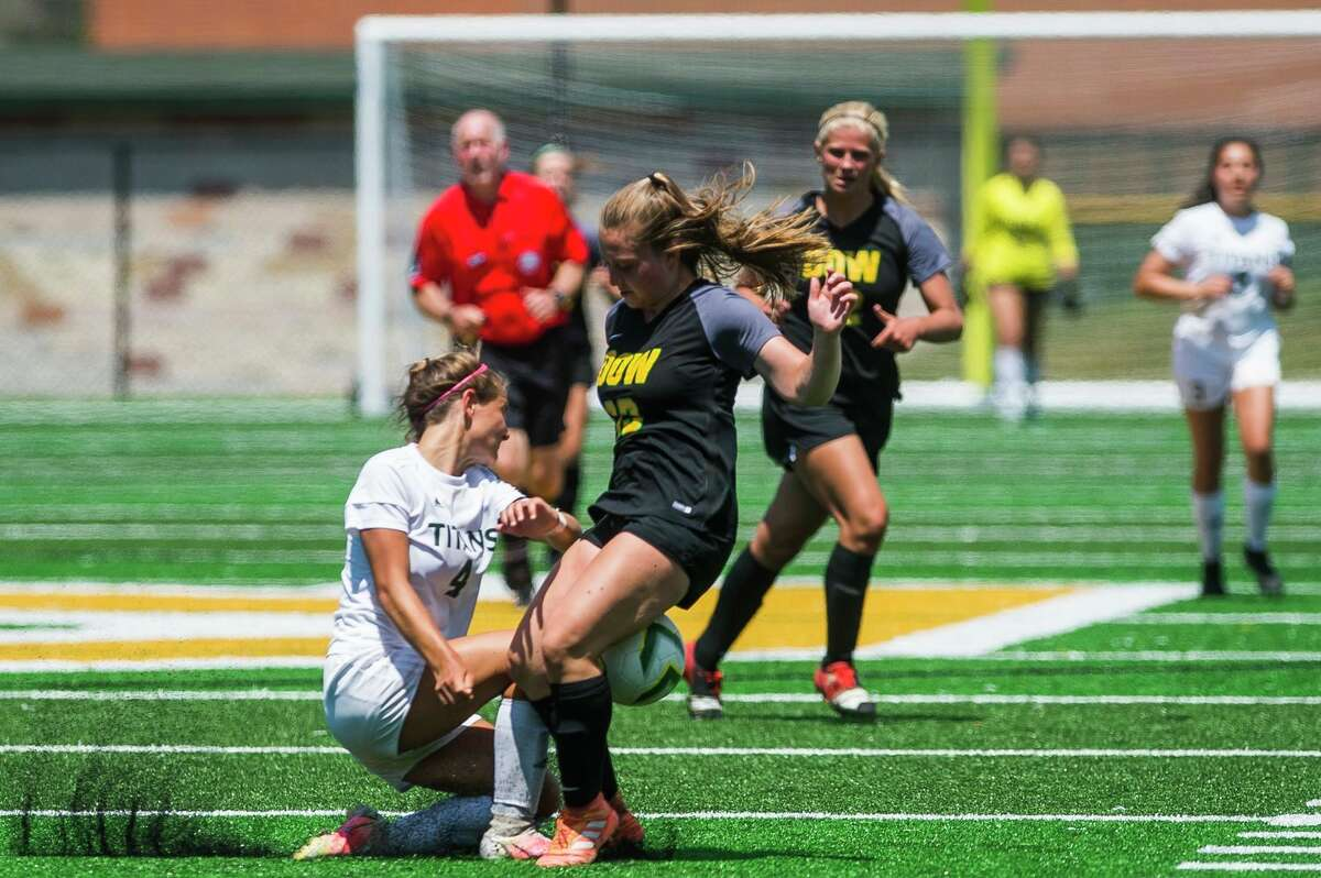Dow's Kylie Chartier fights for possession during the Chargers' district championship win over Traverse City West Saturday, June 5, 2021 at H. H. Dow High School. (Katy Kildee/kkildee@mdn.net)