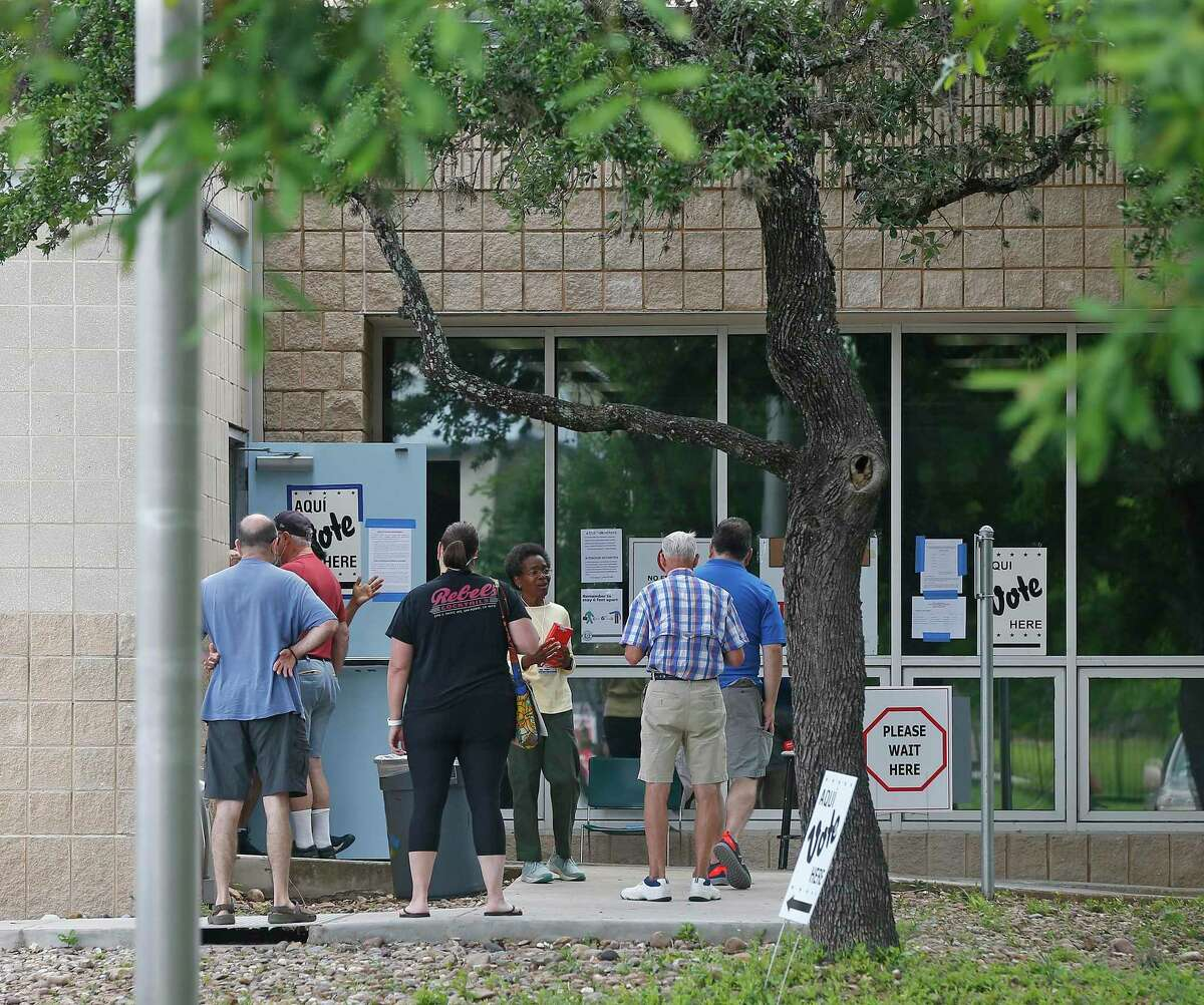 Voters at Brook Hollow Public Library on Saturday, June 5, 2021.
