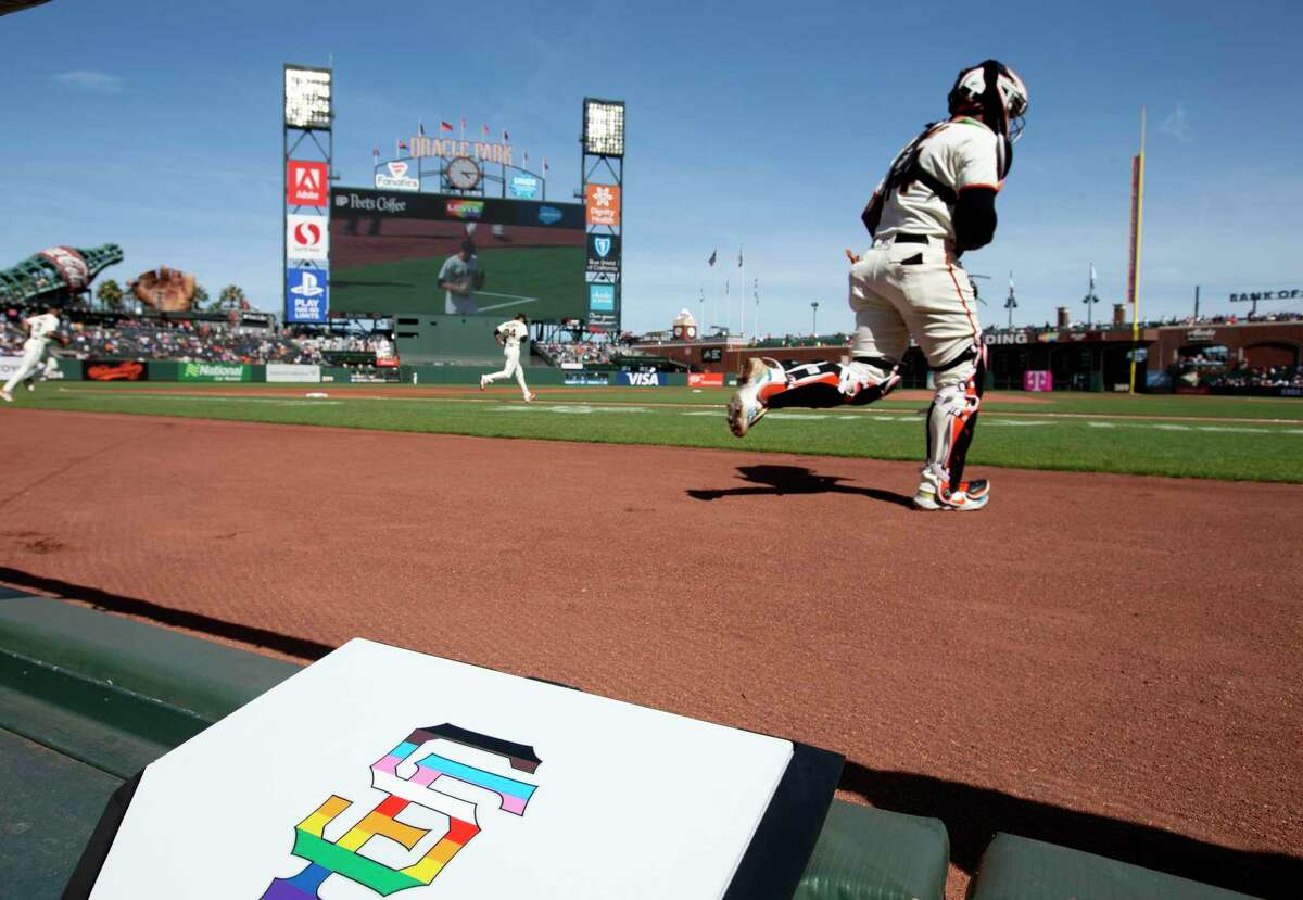 Players take the field past a ceremonial home plate at Oracle Park as the San Francisco Giants celebrate Pride month, before a baseball game against the Chicago Cubs on Saturday, June 5, 2021 in San Francisco, Calif.