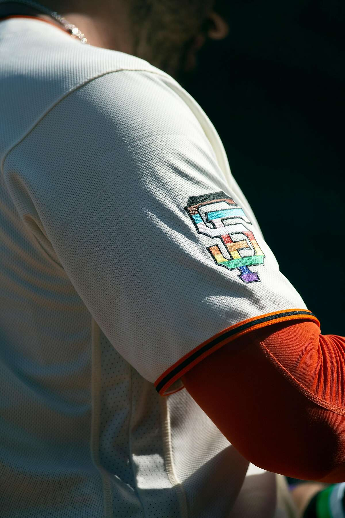 San Francisco Giants sport special rainbow insignias on their uniforms and caps to celebrate Pride month during a baseball game against the Chicago Cubs on Saturday, June 5, 2021 in San Francisco, Calif.