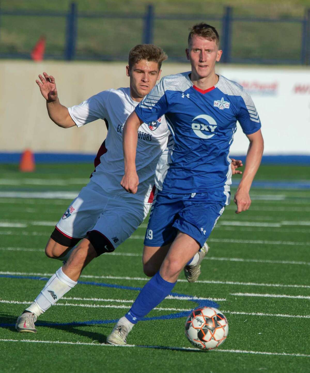Sockers' Ben Quigley brings the ball upfield as Irving's Joe Conway chases 06/05/2021 at Grande Communications Stadium. Tim Fischer/Reporter-Telegram
