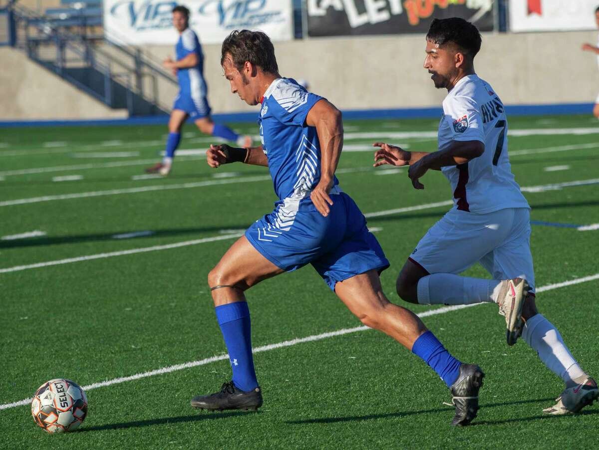 Sockers' Alonso Rodriguez takes the ball down the sideline as Irving's Mark Alvarado chases 06/05/2021 at Grande Communications Stadium. Tim Fischer/Reporter-Telegram