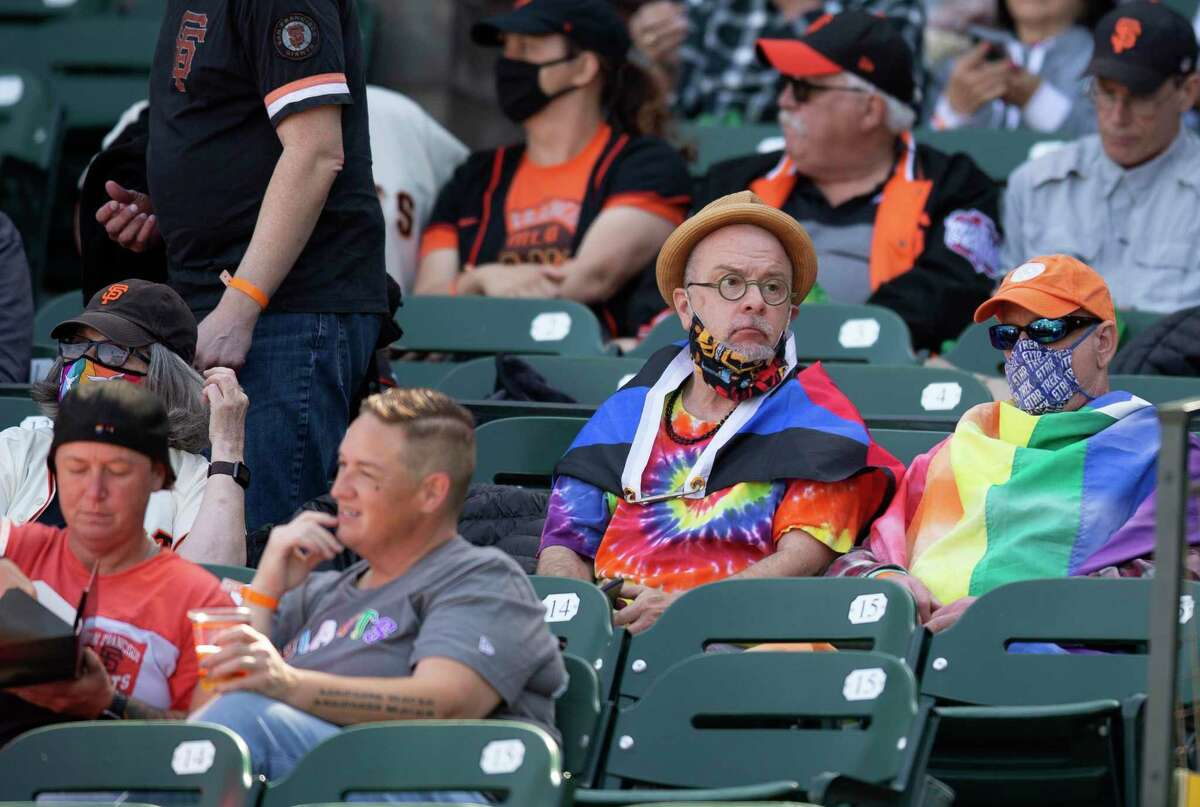 Fans celebrating Pride month with the San Francisco Giants await the start of a baseball game between the Giants and Chicago Cubs on Saturday, June 5, 2021 in San Francisco, Calif.