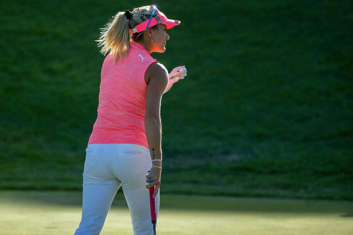 Lexi Thompson acknowledges cheering spectators after finishing a bogey-free 66 to take the lead after three rounds.