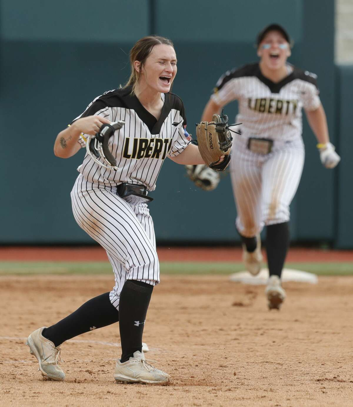 Liberty starting pitcher Kaci West (7) reacts after getting Alaunah Almaraz #11 of Calallen to fly out for the final out of the Class 4A UIL state championship game at Red & Charline McCombs Field, Saturday, June 5, 2021, in Austin. Liberty defeated Calallen 10-3.