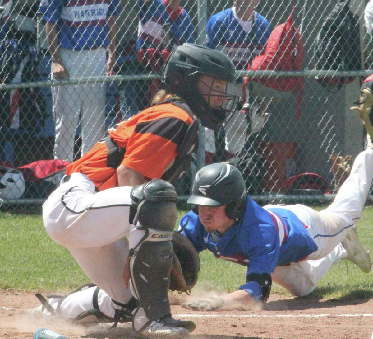 Chippewa Hills' Sam Cole dives safely into third base on Saturday against Ludington in a Division 2 district semifinal game. (Pioneer photo/John Raffel)